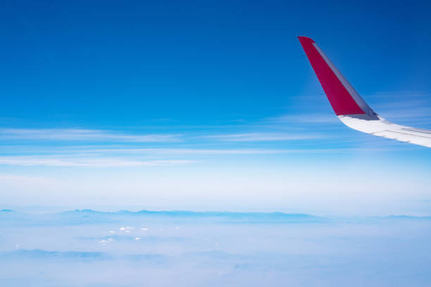 plane flying in the sky, Aircraft wings stock photo