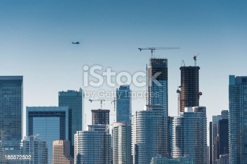 istock Plane flys over the city 185572502