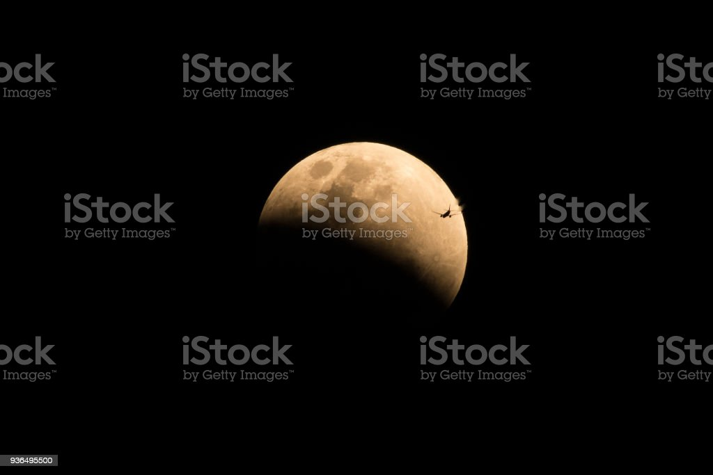Plane going to the moon in Black sky stock photo