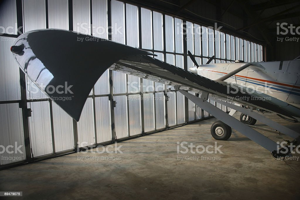 plane in hangar royalty-free stock photo