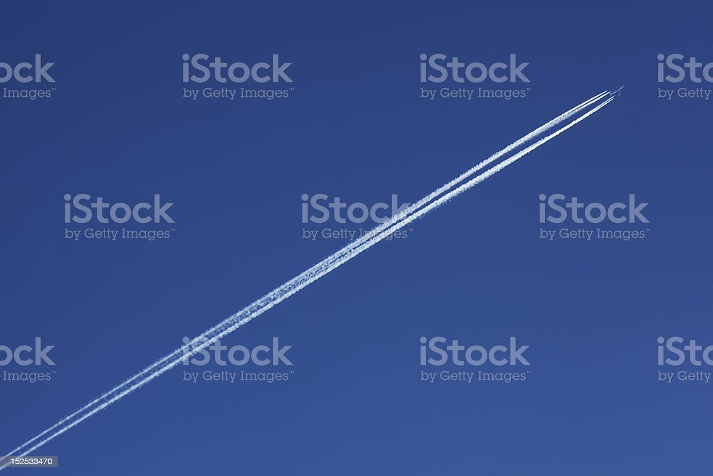 Plane In Sky With Vapour Trail royalty-free stock photo