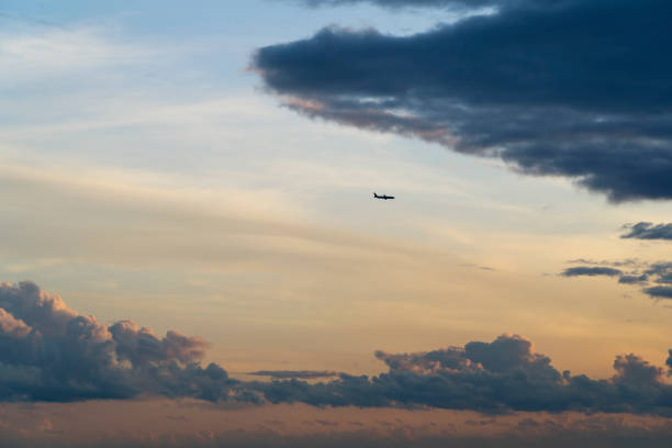 Plane is going into clouds stock photo