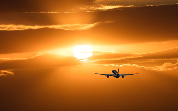 Plane is taking off at sunset stock photo