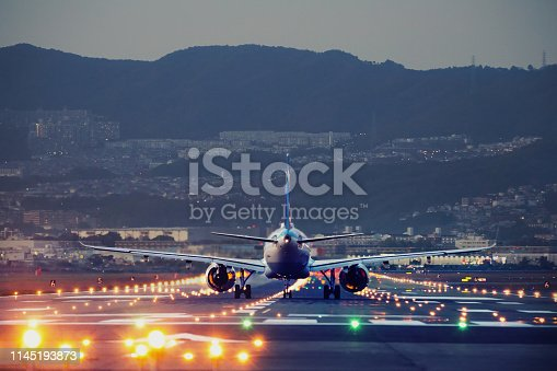 big plane landing at dusk at Osaka-Itami International Airport, Japan
