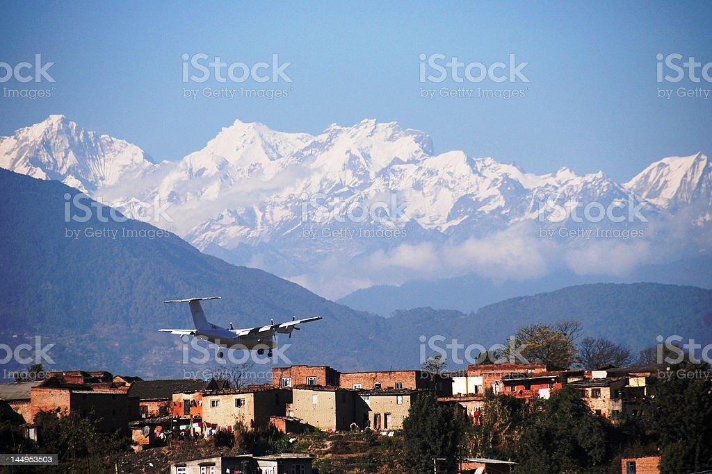 Plane landing in the Himalayas stock photo