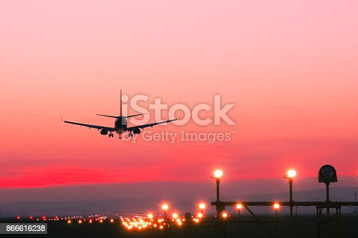 istock Plane lands at an airfield at the sunset 866616238