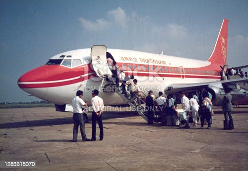 1987 june 25: unidentified woman and crew member wait for aboard to the plane of Hong Kong Dragonair in Kai Tak airport .one of the long history airline in Hong Kong, after that it renamed to cathay dragon under the brand of cathay pacific