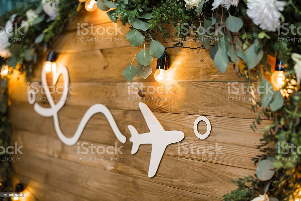 plane on wooden boards decorated with flowers. distance and lov stock photo