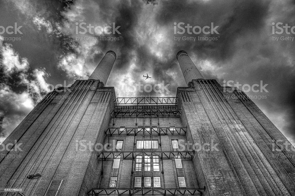 Plane over Battersea Power Station stock photo