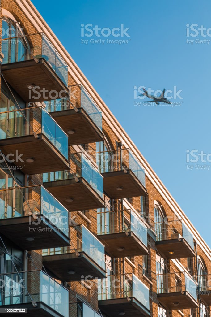 Plane over Flats stock photo