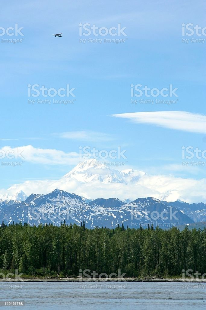 Plane over Mt. McKinley stock photo