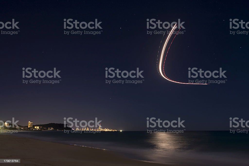 Plane over night beach stock photo
