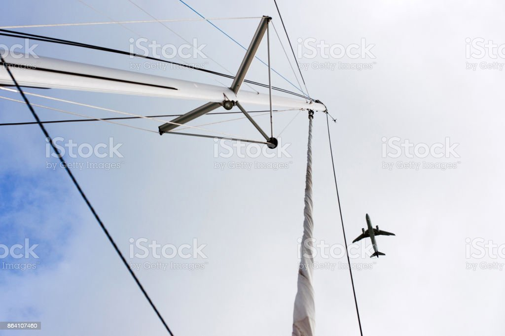 Plane over the mast royalty-free stock photo