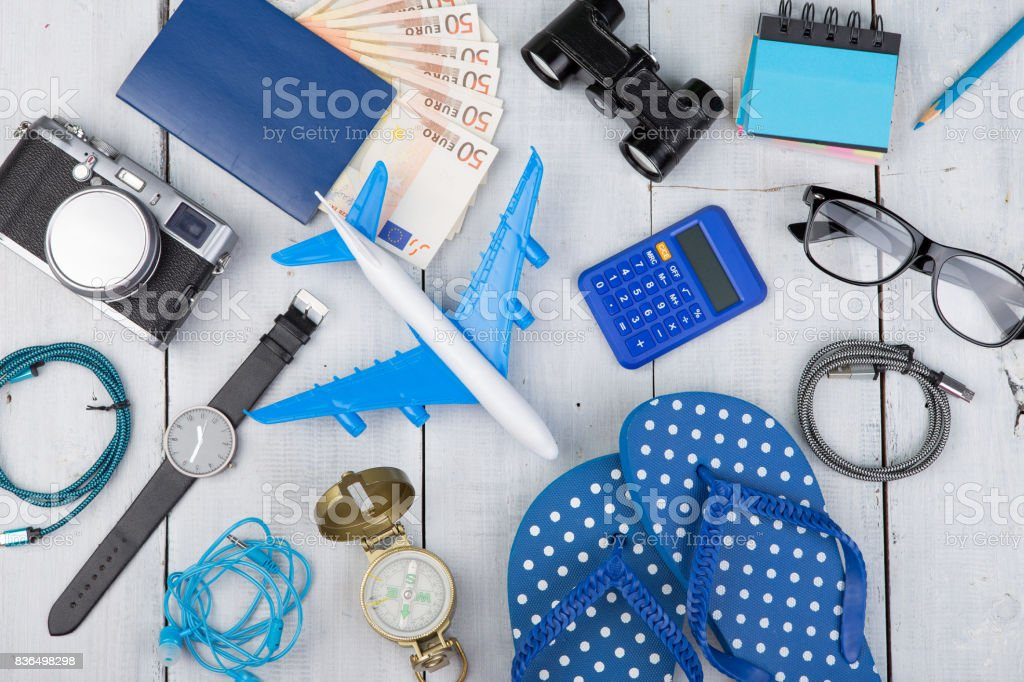 plane, passport, money, camera, compass, binoculars, watch, flip flops stock photo