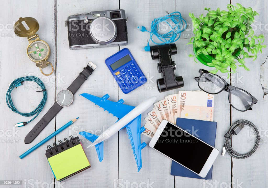 plane, passport, money, camera, compass, headphones, binoculars, smartphone stock photo
