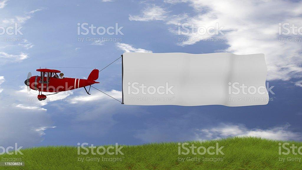 Avion en tirant une bannière sur green field - Photo