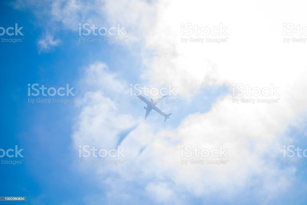 Plane reflected in the clouds of Ibiza stock photo