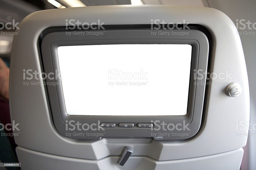 Plane seat with tv screen (copy space) stock photo