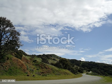 istock Plane soars above Angel Island hills with winding road 540195490