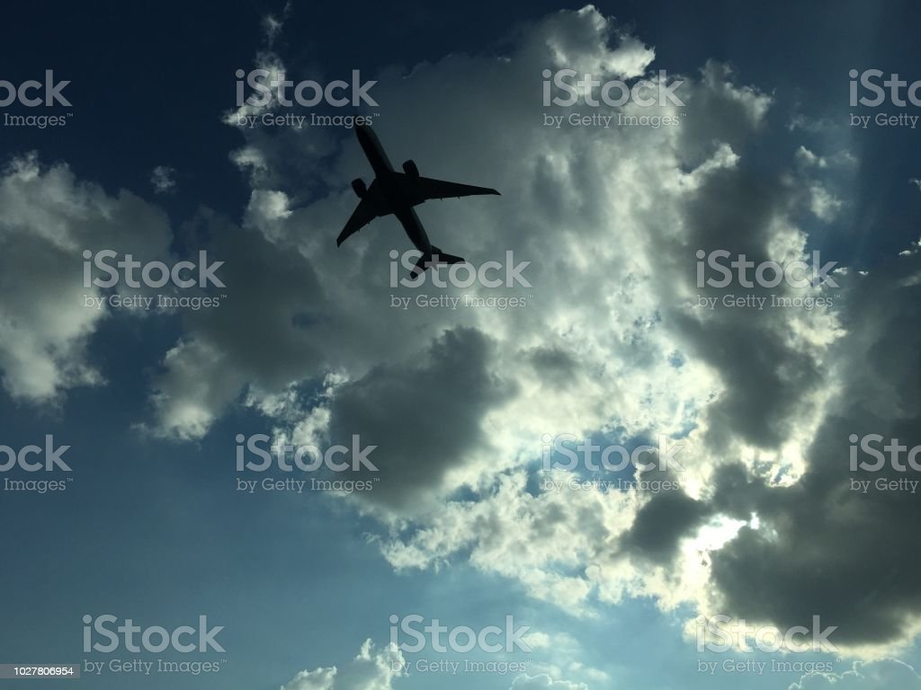 Plane taking off in a dramatic sky stock photo
