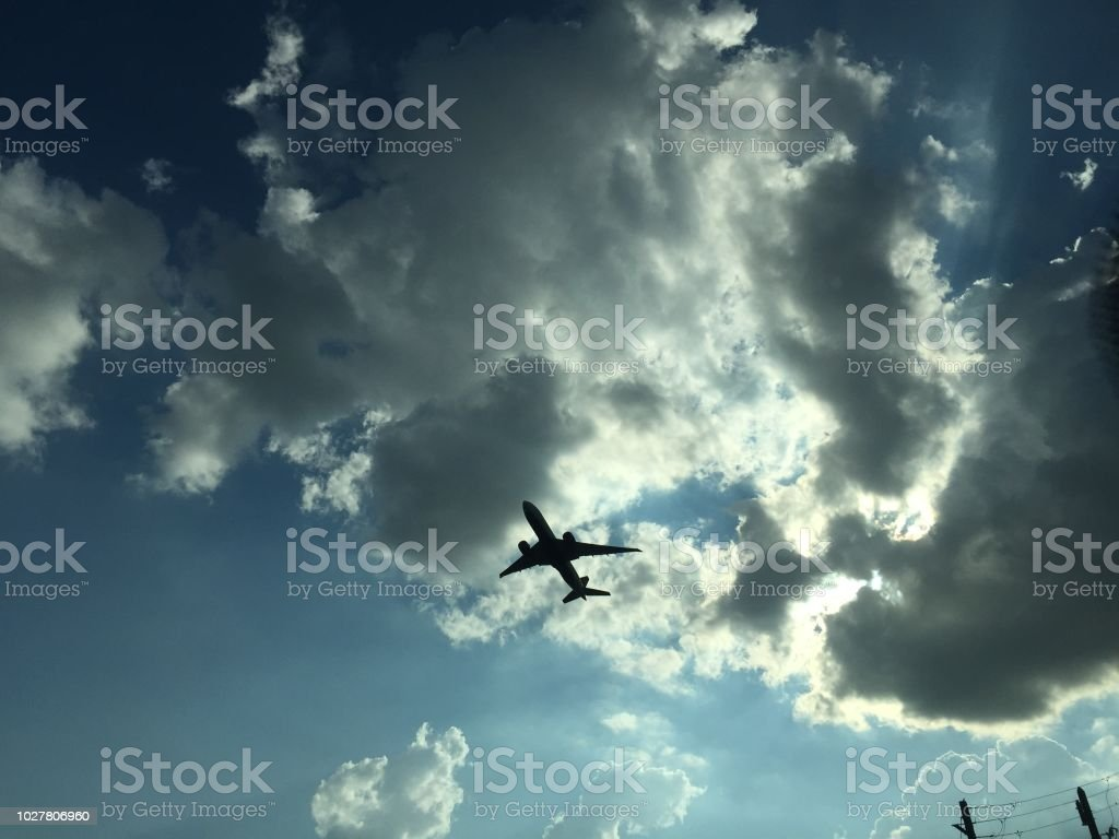 Plane taking off with a dramatic sky backdrop stock photo