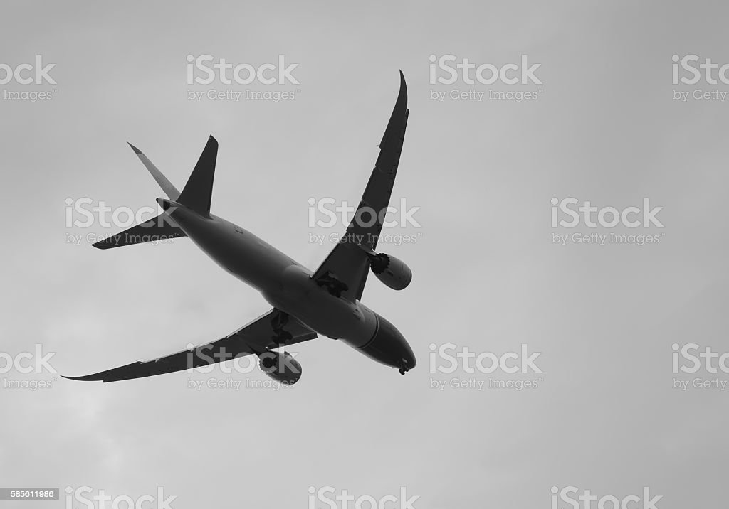 plane was landing on dark clouds and sky stock photo