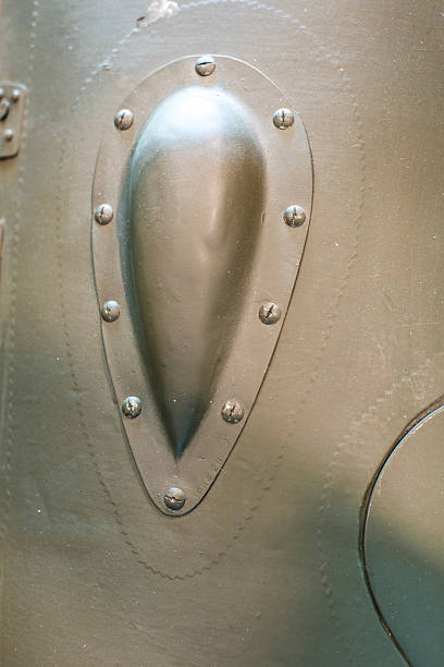 WW2 plane wing aerodynamic bulge with riveted panel lines. - Photo
