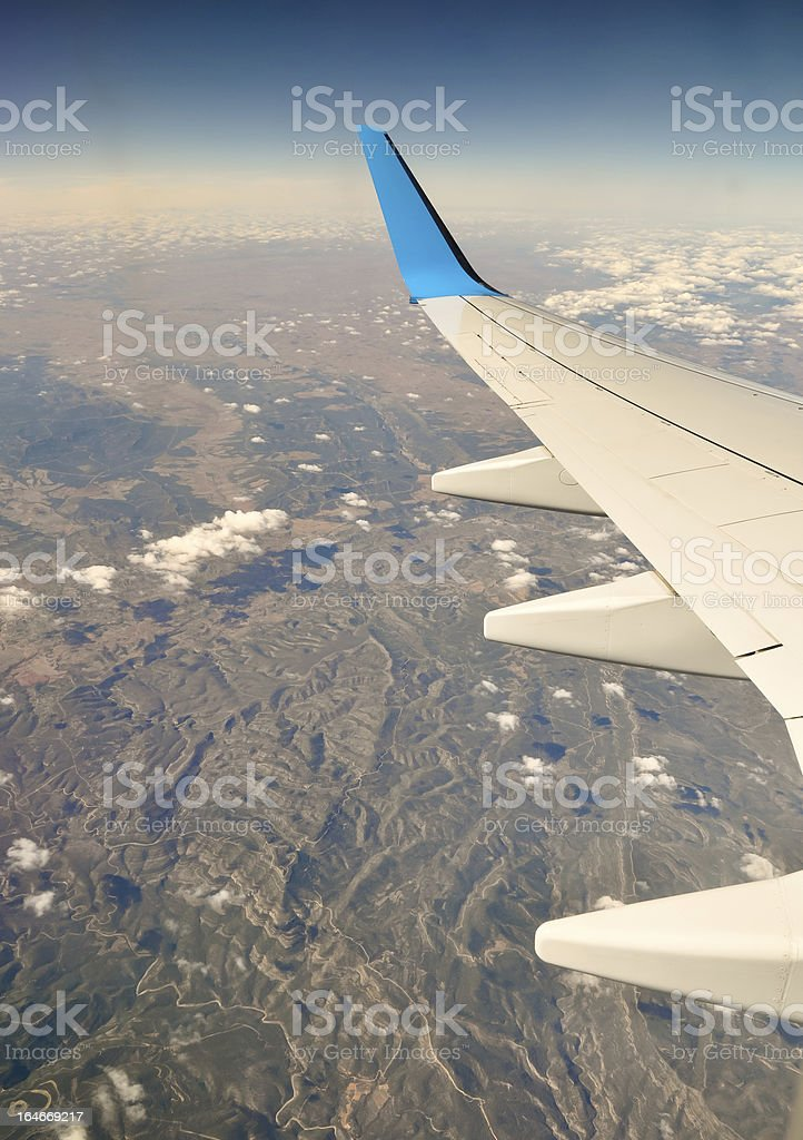 Plane wing over Spain royalty-free stock photo