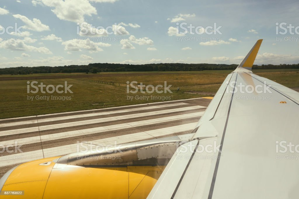 Plane wing with yellow fuselage motor part stock photo