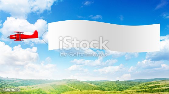 istock Plane with a banner 498978729