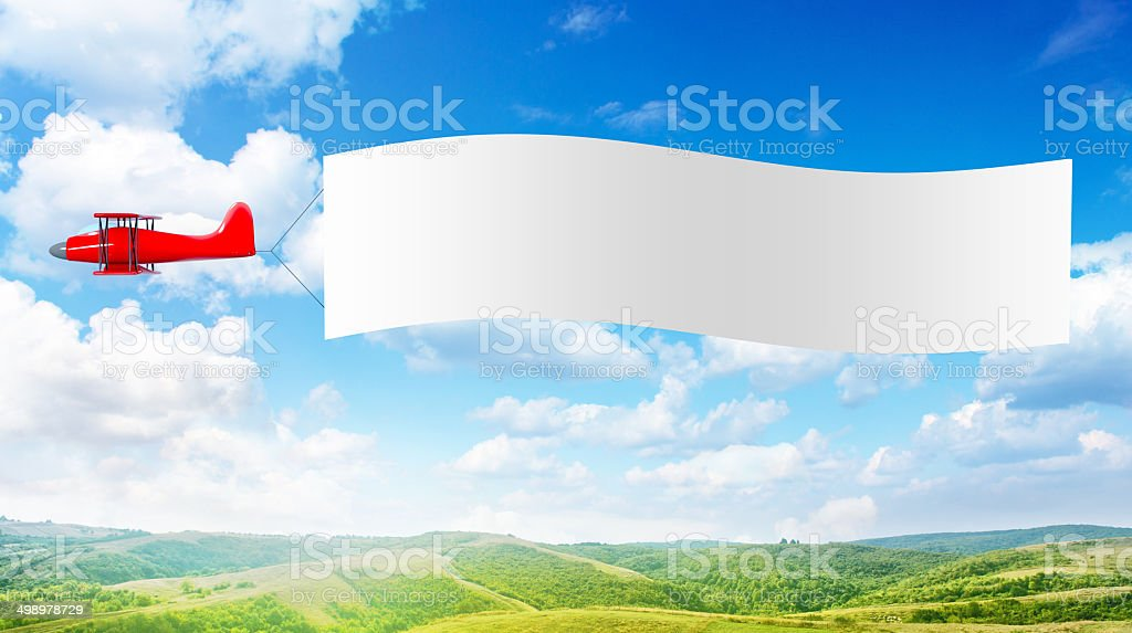 Plane with a banner stock photo