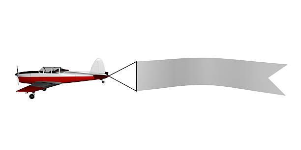 Avião com banner - fotografia de stock