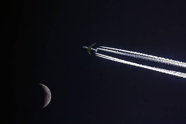 Plane with moon stock photo