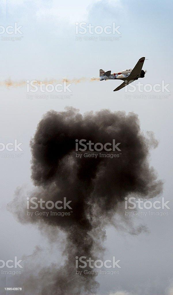 Plane with smoke bomb royalty-free stock photo