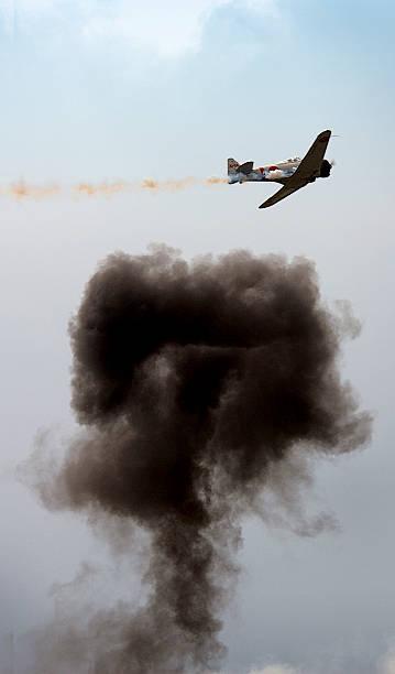 Plane with smoke bomb stock photo