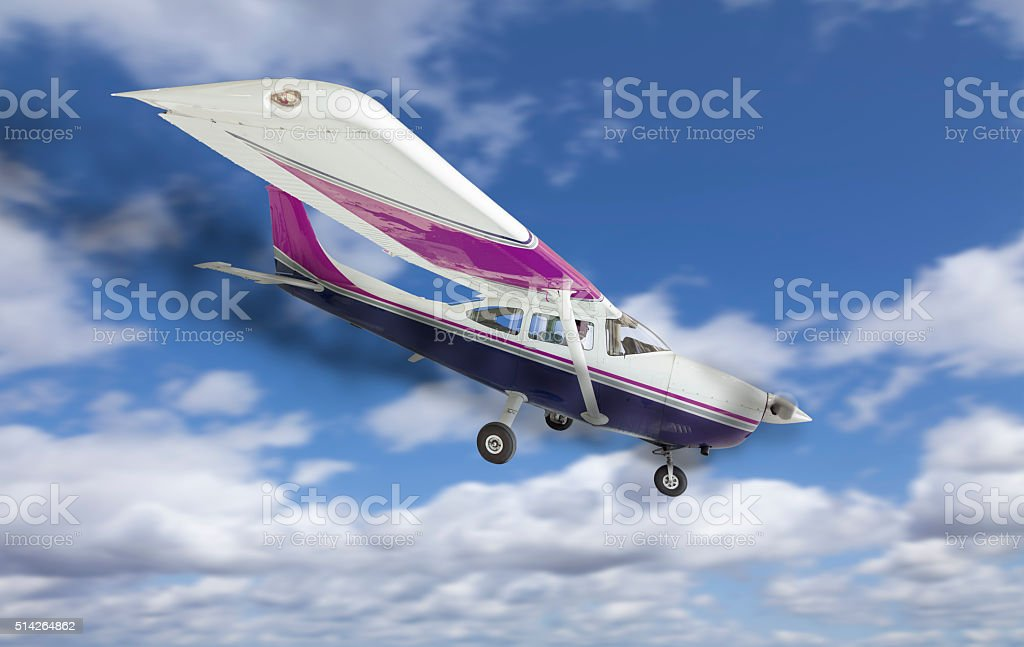 Plane with Smoke Coming From The Engine Heading Down stock photo