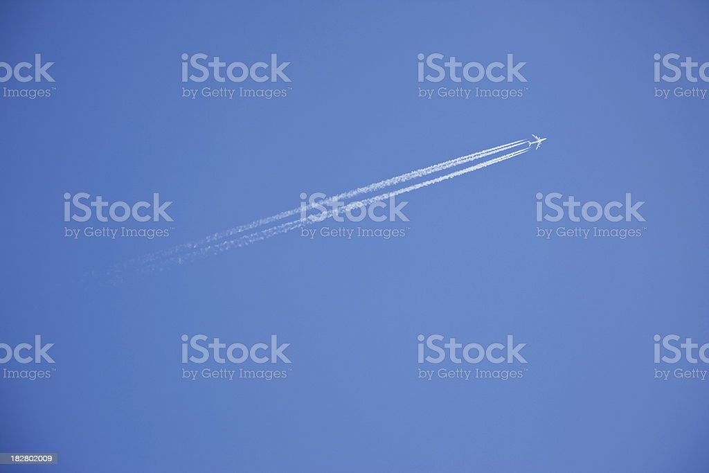 Plane with vapor stripes # 10 royalty-free stock photo