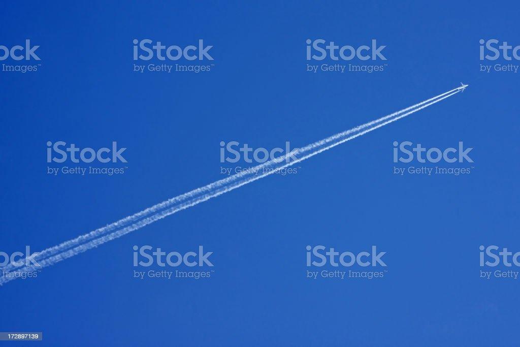 Plane with vapor stripes # 2 XL royalty-free stock photo