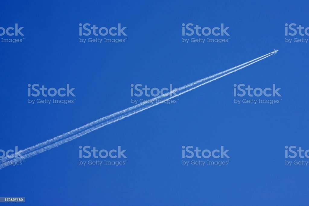 Plane with vapor stripes # 2 XL stock photo