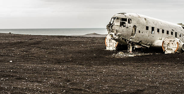 Plane wreck in wilderness Lost plane wreck in wilderness of Iceland sólheimasandur stock pictures, royalty-free photos & images
