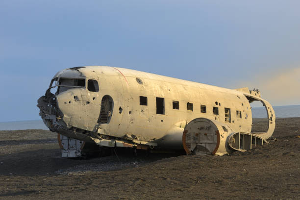 Plane Wreck on Iceland Beach at Sunset stock photo