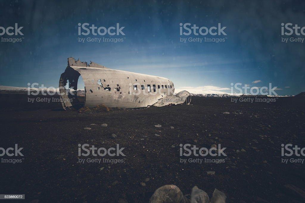 Plane Wreckage in Iceland on Black Sand Beach stock photo