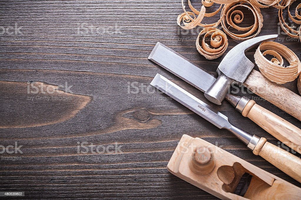 Planer claw hammer metal firmer chisels and wooden curled shavin stock photo