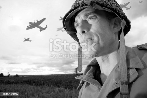 World War 2 soldier and planes invade Normandy, France. Photographed on location during the 65th anniversary of D Day. The planes were shot the same day and added to the photo.