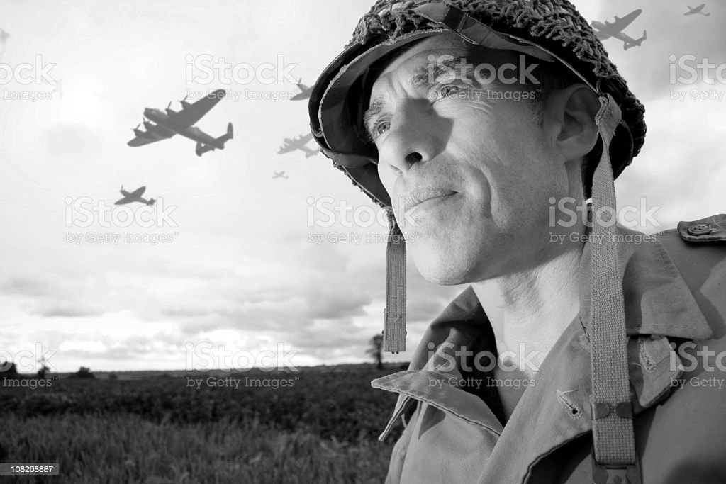 Planes Flying Over Soldier, Black and White stock photo