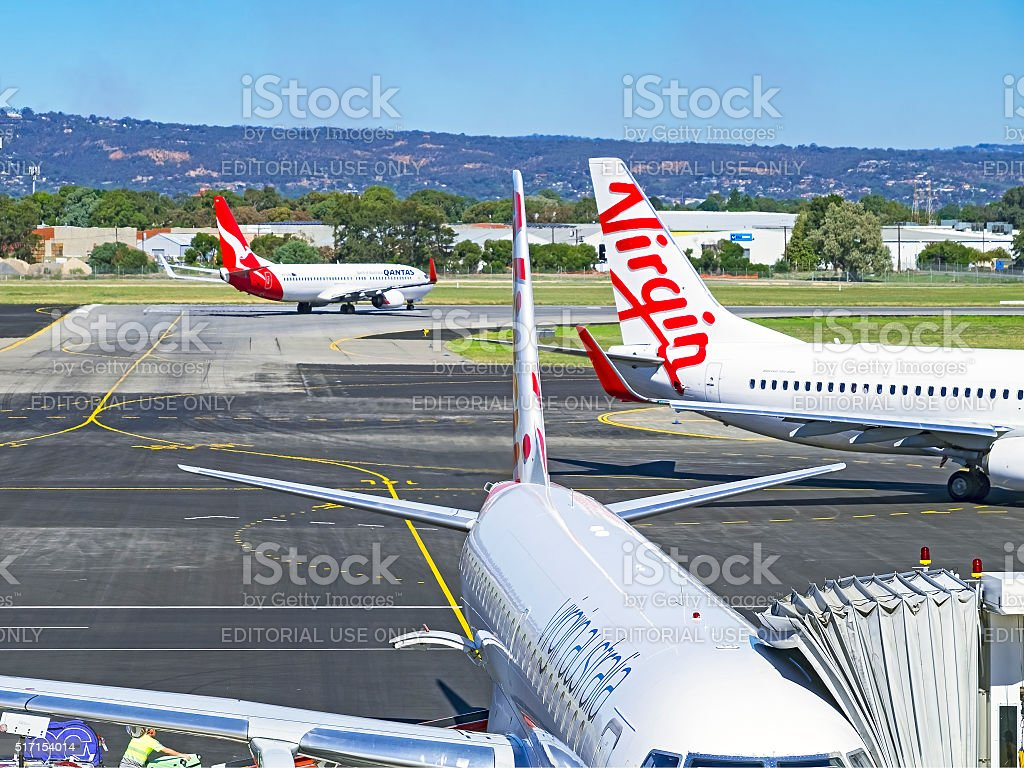 Planes from rivals Qantas and Virgin at Adelaide airport stock photo
