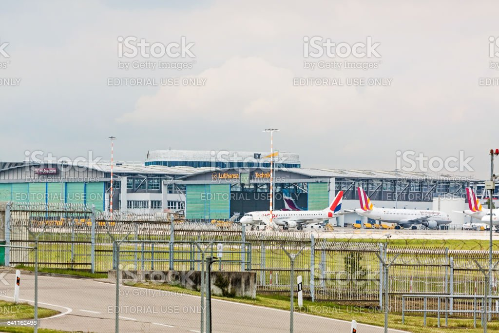 planes in front of Lufthansa Technik hangar stock photo