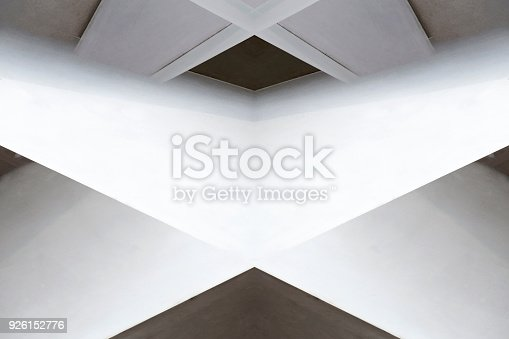 istock Planes inclined at several different angles. Digitally rendered tilt image of architectural fragment in backlight. Abstract black and white modern architecture background with X-shaped central element. 926152776