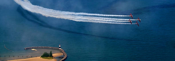 planes over water - airshow stock photos and pictures