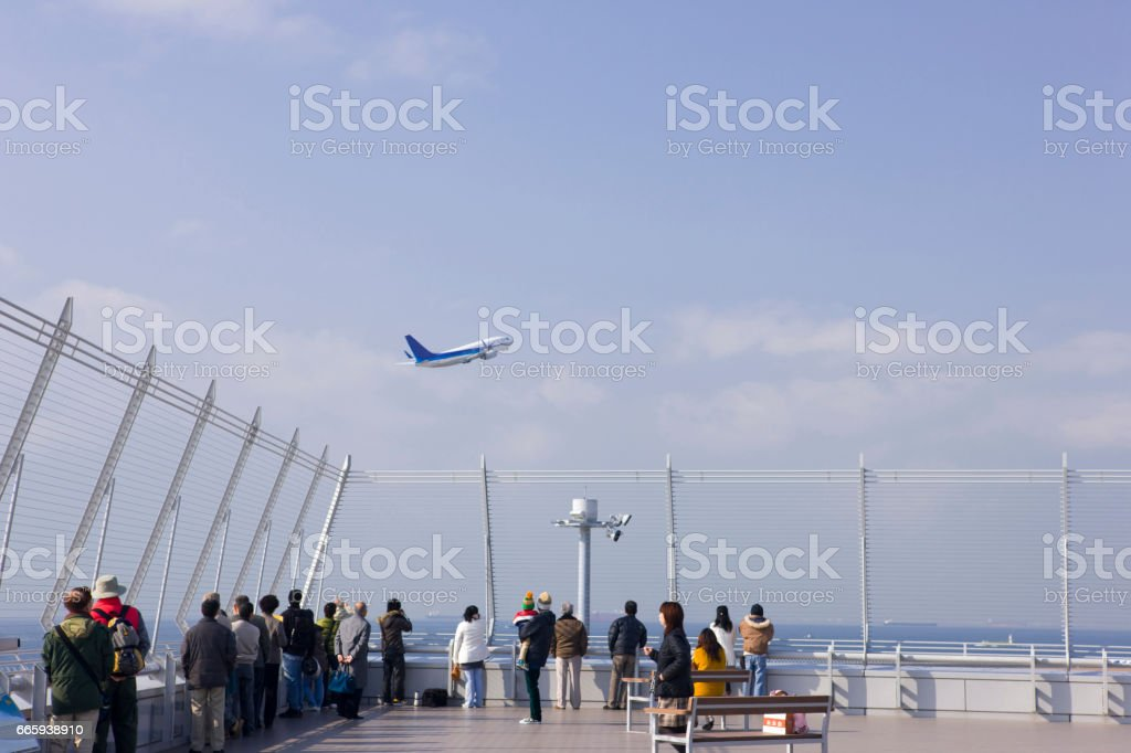 Planes to take off and spectators stock photo